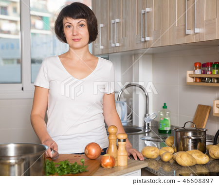 Portrait of positive housewife 46608897