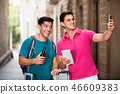 Men tourists with beer are making selfie in unknown city. 46609383