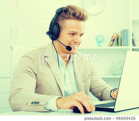 Young man working in call centre 46609426