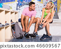 Man and woman equipping for climbing workout 46609567