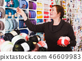 Mature customer in yarn shop 46609983
