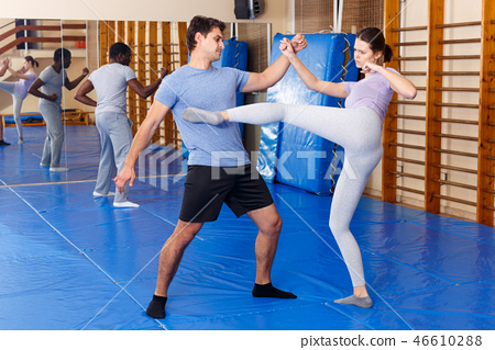 People practicing self defense techniques 46610288