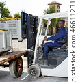 African American male using forklift for unload boxes with grapes at winery 46611231
