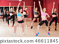 Group of young fitness women dancing zumba 46611845