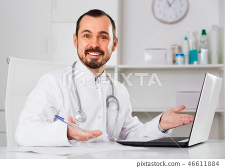 Male doctor having a productive day helping 46611884