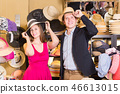 young wife and husband choosing dress hats in the store 46613015