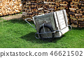 Wood and steel cart with rubber tire on green lawn 46621502