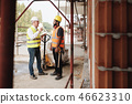 Portrait Of Happy Construction Site Supervisor Talking To Manual Worker 46623310