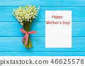 Happy Mother's day text on blue rustic wooden background. greeting card concept spring flowers flat 46625578