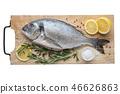 Dorado fish with lemon slices, salt and rosemary 46626863