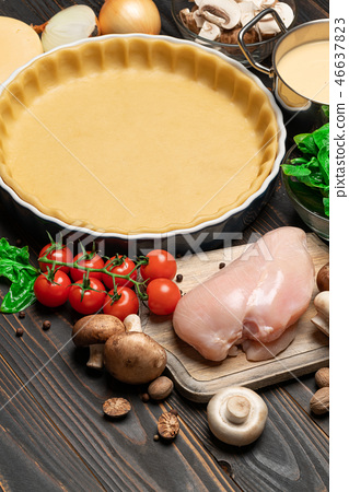 shortbread dough for baking quiche tart and ingredients in baking form 46637823