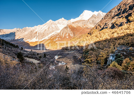 Holy mountain range with waterfall in pine forest 46645706