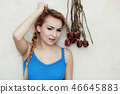 Blond woman teenage girl showing her damaged dry hair 46645883