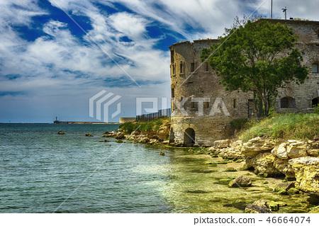 Old damaged by war fort in the Black Sea coast. Coastal Michael's fortress in Sevastopol, Crimea 46664074
