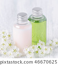 natural cosmetic bottles with fresh flowers, white and green 46670625