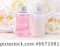 natural cosmetic bottles with fresh rose flowers, organic beauty treatment 46671081