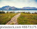 The dirt road to the fjord. Nature of Norway 46673175