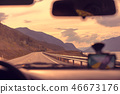 Driving a car on a mountain road 46673176