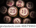 Wooden lotto kegs with two numbers as symbol 2019 46679960