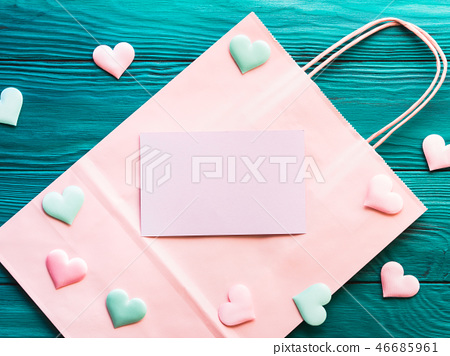 Pink blank card on shopping bag with hearts 46685961