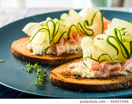 Rye bread toasts with cheese, ham, cucumber 46685986