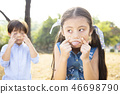 little boy and girl pulling a funny face 46698790
