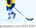 Legs of the hockey player, stick and washer  46714587