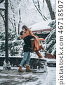 young guy and beautiful girl kiss in a snowy park 46718507