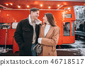 beautiful young couple posing by the old bus 46718517
