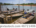 Small fishing boats parked near the river. 46721406