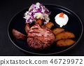 roasted cutlet with crunchy bacon and potatoes 46729972
