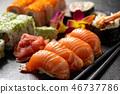 Mix sushi set, on black stone background. 46737786