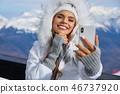 Young woman taking a selfie in winter holiday in mountain.Young 46737920
