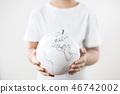 child's hand with globe white on white background 46742002