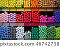 Different rainbow markers or pens on the shelfs. 46742738