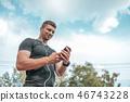 A man athlete calls ringing in headphones. 46743228