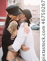 A young, sexy couple of lovers pose for a camera on the streets 46750267