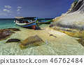 Large stones with a tourist boat 46762484