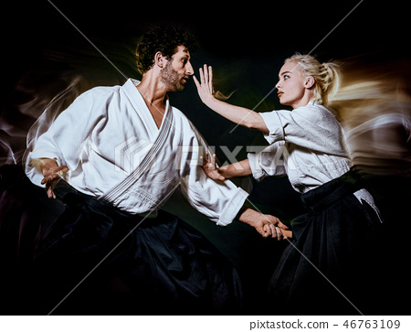 Aikido bodokas man and woman isolated black background 46763109