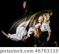 Aikido bodokas man and woman isolated black background 46763110