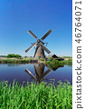 dutch windmill over river waters 46764071