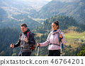 Portrait of happy couple hiking in the countryside at summer 46764201