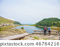 young couple of backpackers near the lake in mountains 46764216