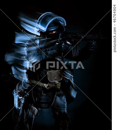 one soldier police swat tactical forces man isolated black backg 46764904