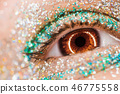 Macro brown female eye with glitter eyeshadow, colorful sparks, crystals. Beauty background, fashion 46775558