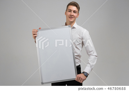 Portrait of young man with clean magnetic Board in his hands isolated on white background 46780688