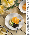poached apples & fresh orange with chocolate sauce 46797737