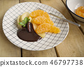 poached apples & fresh orange with chocolate sauce 46797738