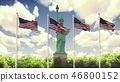The American flags flutters in the wind on a Sunny day against the blue sky and the Statue of 46800152