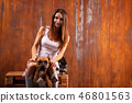 Beautiful woman with dog and raccoon 46801563